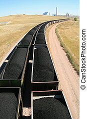 coal train and power plant - cars from a coal train lead off...