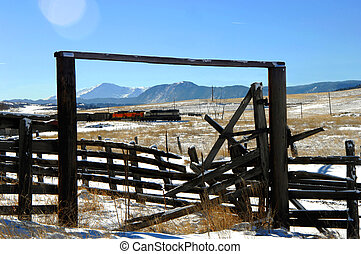 Coal Train Delivery - Old corral frames a coal train as it ...