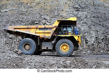 Coal truck working on site - panning shot a dump truck...