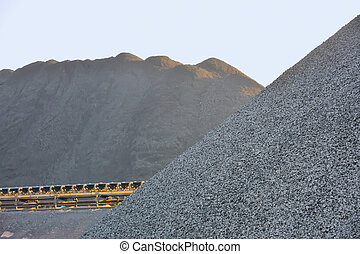 Coal yard in heaps for industrial use - Coal yard with...