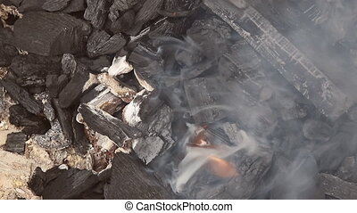 Coals burning barbecue embers glowing in red fire