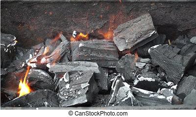 coals burning in brazier