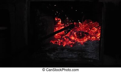 coals in the furnace goes through with a fireplace - poking ...