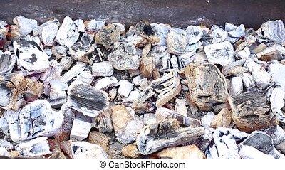 Coals smolder in the barbecue - Burnt gray coals smolder in...