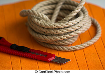 Coarse rope roll and a knife with