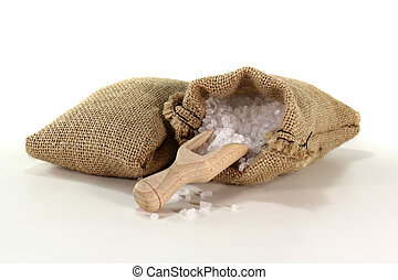 coarse salt grains on a bushel with salt in the bag