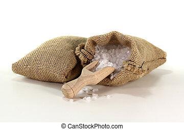 coarse salt grains on a bushel with salt in the bag