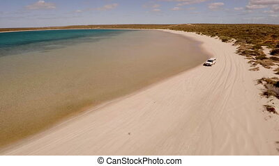 Coast and sea shot with a ute on lands
