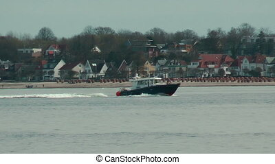 Coast Guard cruising near Laboe beach, Germany