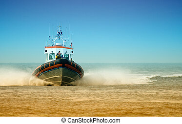 coast guard full speed towards the beach