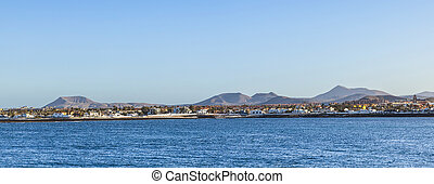 coast in Corralejo with houses at the canarian island Fuerteventura