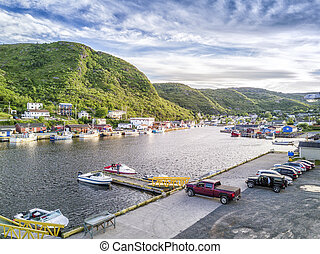 Coast in Petty Harbour at sunset, Newfoundland, Canada -...