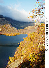 Coast mountain lake and autumn forest
