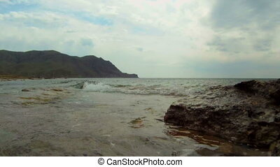 Coast - Ocean waves rolled on a rocky shore.
