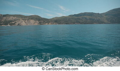 Coast of Crimea. Black Sea from the speed boat on a sunny day