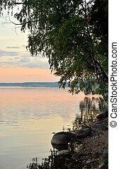 Coast of lake at summer evening.