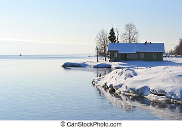 Coast of Onega lake, sunny winter day.
