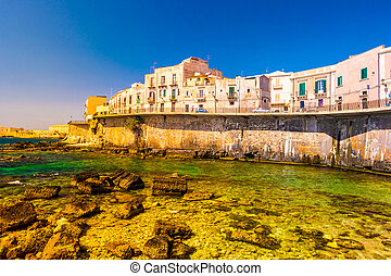 Coast of Ortigia island at city of Syracuse, Sicily, Italy....