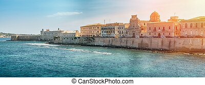 Coast of Ortigia island at city of Syracuse, Sicily, Italy -...