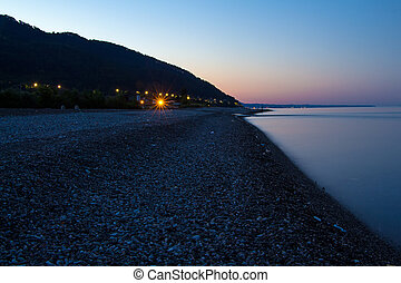 Coast of sea with mountains in early morning