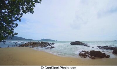 Coast of the Andaman Sea in cloudy weather. Phuket, Thailand