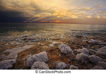 Coast of the Dead Sea in thunder-storm. The salty...