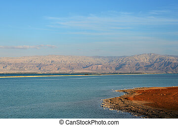 Coast of the Dead Sea lit by the evening sun