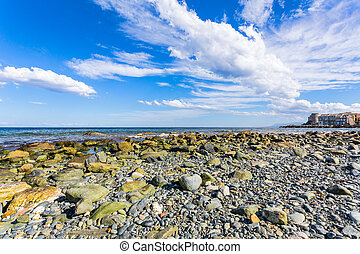 Coast village on a stones beach
