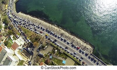 Coast way from above at Salacak, Uskudar in Istanbul. View from aerial camera. Car traffic and parked cars along the street. Birds eye view