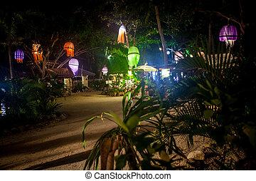 Coastal cafes at night with flashlights as jellyfish. Koh...