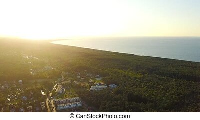 Coastal city in woods from drone - Aerial shot taken with...