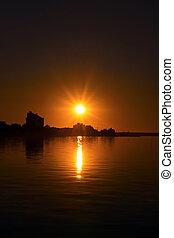 Coastal city on sunset