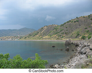 Coastal cliffs, coastline, rocky shore, the view from the sea side, Crimea peninsula, Ukraine, Black Sea Coast