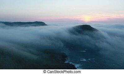 Coastal fog at sunrise - Foggy morning along the...