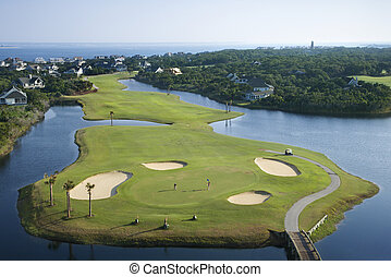 Coastal golf course. - Aerial view of golf course in coastal...