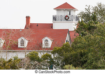 Coastal Home with Red Roof at Christmas