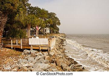 Coastal Homes Along Rocky Seawall