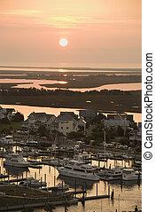 Aerial view of coastal village with marina on Bald Head Island, North Carolina.