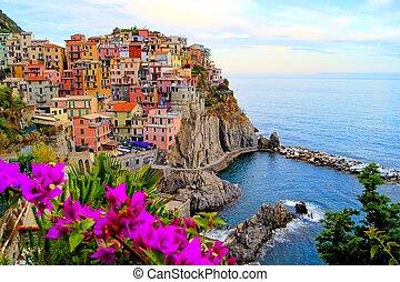 Coastal Italian village with flower