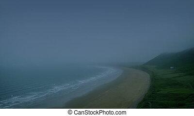 Coastal Landscape At Dusk - Dramatic misty sea shore in the...