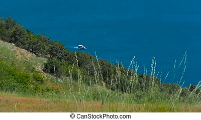 Coastal landscape - Motorboat is moving rapidly along the...