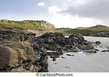 coastal landscape on scottish isle with wetland and hills