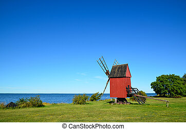 Coastal old windmill - Old windmill by the coast of the...