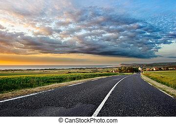 Coastal road at sunset