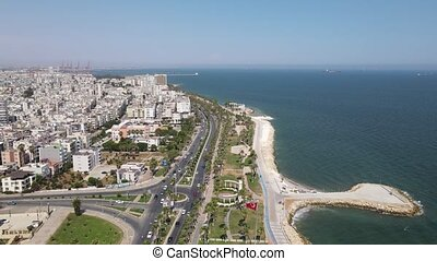 Drone view with the movement of vehicles and sea views on a wonderful coastline