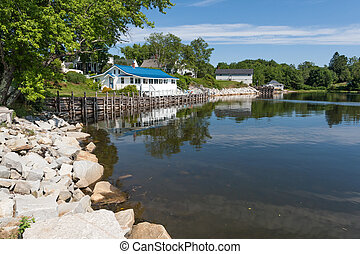 Coastal scene of Maine - Pilings and houses along the shore...