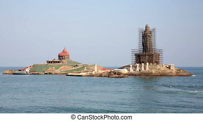 Coastal scene with Hindu statue under renovation