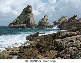 rocky coastal scenery on a caribbean island named Guadeloupe