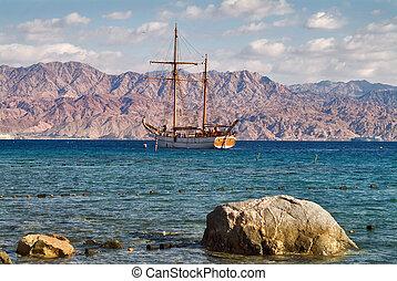 Coastal stones. - Enormous picturesque stones and a sailing...