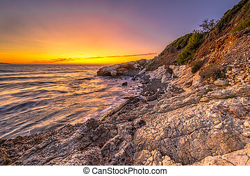Coastal sunset Cap Corse - Colorful sunset on the rocky ...